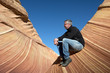 "Man relaxing on ""The Wave"", Paria Canyon"
