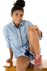 Attractive tan teen girl in a casual portrait pose