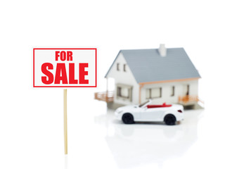 For sale sign and house model and car.jpg
