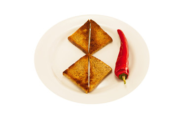 two heart-shaped toast and spicy red pepper