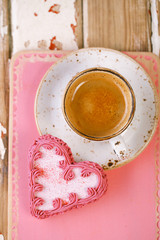 red heart cookies and espresso Coffee cup on old wooden table
