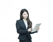 Beautiful asian businesswoman standing and working with tablet.