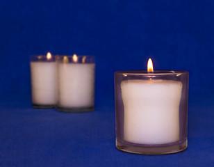 Group of memorial wax yahrzeit candles in glass jar