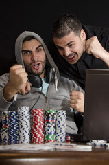 Friends celebrating online poker win