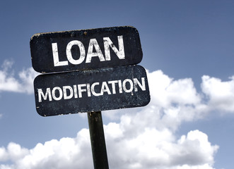 Loan Modification sign with clouds and sky background