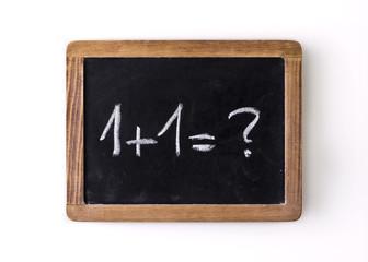"""Question """"1+1=?"""" written on a slate"""