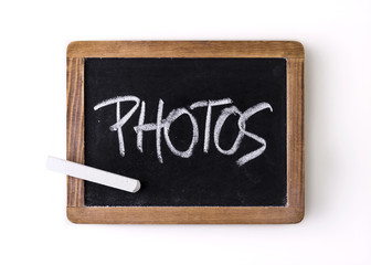 "Word ""Photos"" written on a slate"