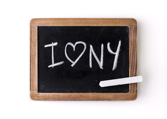 "Expression ""I love NY"" written on a slate"