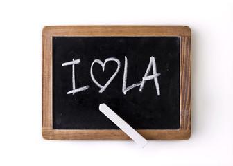 "Expression ""I love LA"" written on a slate"