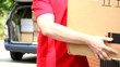 Delivery man holding cardboard package film