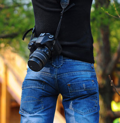 Woman photographer, rear view