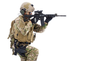 Soldier holding  rifle or sniper and ready to shot