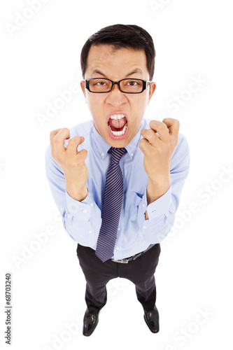 businessman yelling and make a fist . isolated on white