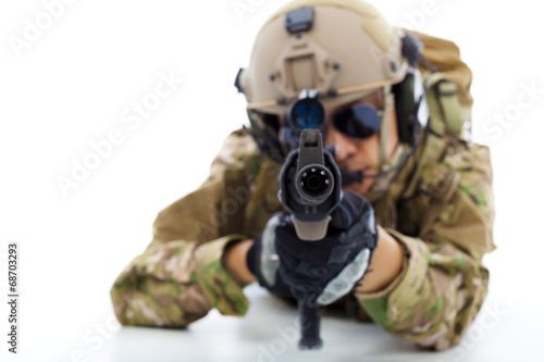 Soldier with rifle against and lying on floor.isolated on white