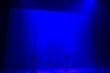 Blue stage spotlights with three stools