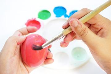 Children's hand painting Easter eggs