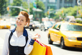 Fototapety Shoppping woman in New York City, background yellow cab