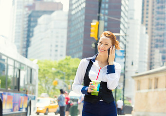 Business woman on smart phone in New York City, Manhattan