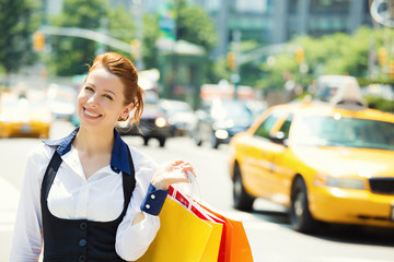 Shoppping woman in New York City, background yellow cab