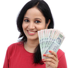 Woman holding Indian currency notes against white background