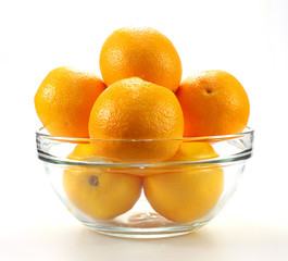 Tasty mandarines in bowl on white