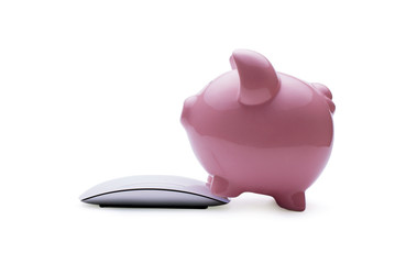 Pink piggy bank investing in savings online