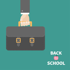 Hand holding black schoolbag briefcase. Flat design style.