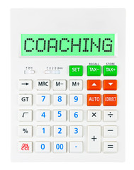 Calculator with COACHING on display on white background