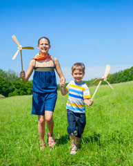 Kids in summer day holds windmill