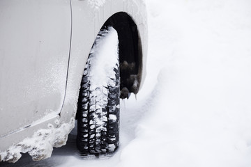 Car with winter tyre in the snow.