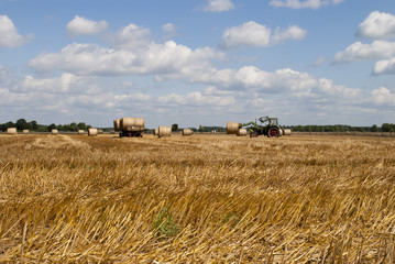 Tractor Hauling Hay Bales on Wagon