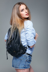 beautiful girl is in fashion style on grey , glamour