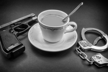 coffee detective, pipe gun and handcuffs