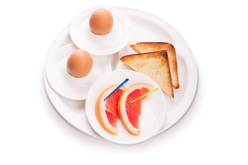 Vegetarian breakfast from eggs,bread and grapefruit