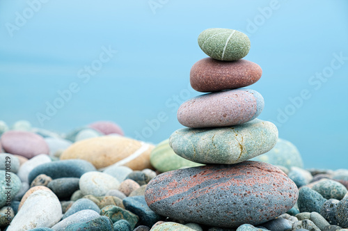 stack of stones on the beach and sea background - 68710829