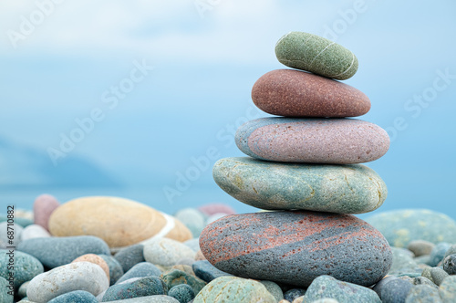 stack of stones on the beach and sea background - 68710882