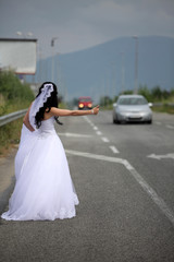 bride hitchhiking on the highway