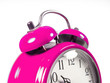 an old alarm clock old pink