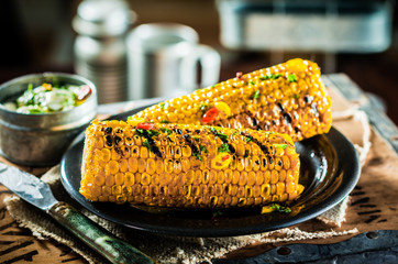 Two tasty grilled corncobs