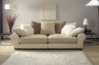 cream sofa in modern living room with rug - 68714482