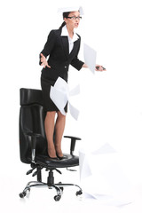 angry businesswoman shouting when standing on chair.