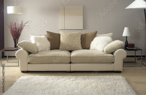 Leinwandbild Motiv cream sofa in modern living room with rug