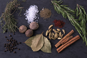 Various Spices and Herbs on Black Background