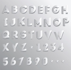 Paper cut and folded alphabet and numbers
