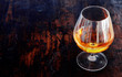 Glowing cognac in an elegant snifter glass