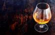 Glowing cognac in an elegant snifter glass