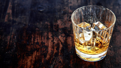 Glass of whiskey, bourbon or scotch, with ice