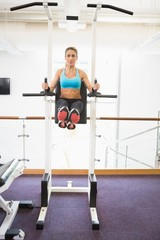 Fit woman doing crossfit fitness workout in gym