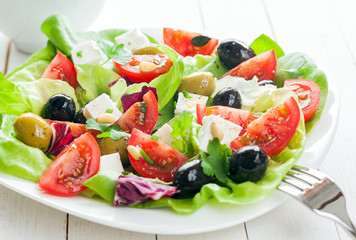 Plate of fresh salad with feta and olives