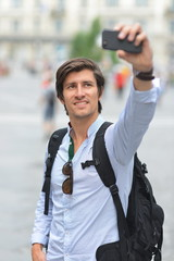 Student / tourist taking self portrait in the europe street